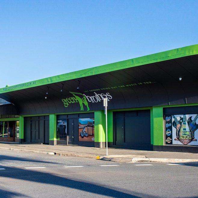 Green Brothers Rockhampton, building signage design Signage Design | FMSTUDIOS